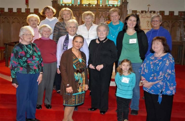 fourteen women in group on red carpet