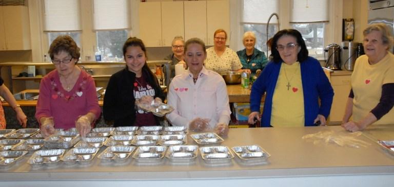 eight women working in a kitchen
