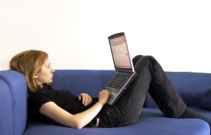woman with computer on couch